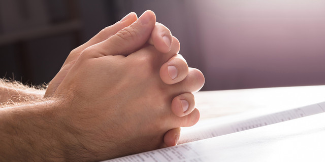 WEB3-MAN-HANDS-PRAY-BIBLE-Shutterstock-792867121